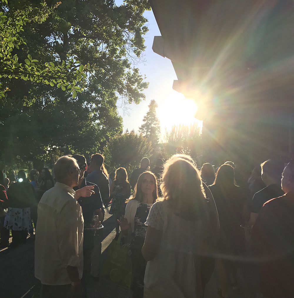 sunset over people gathering for a party