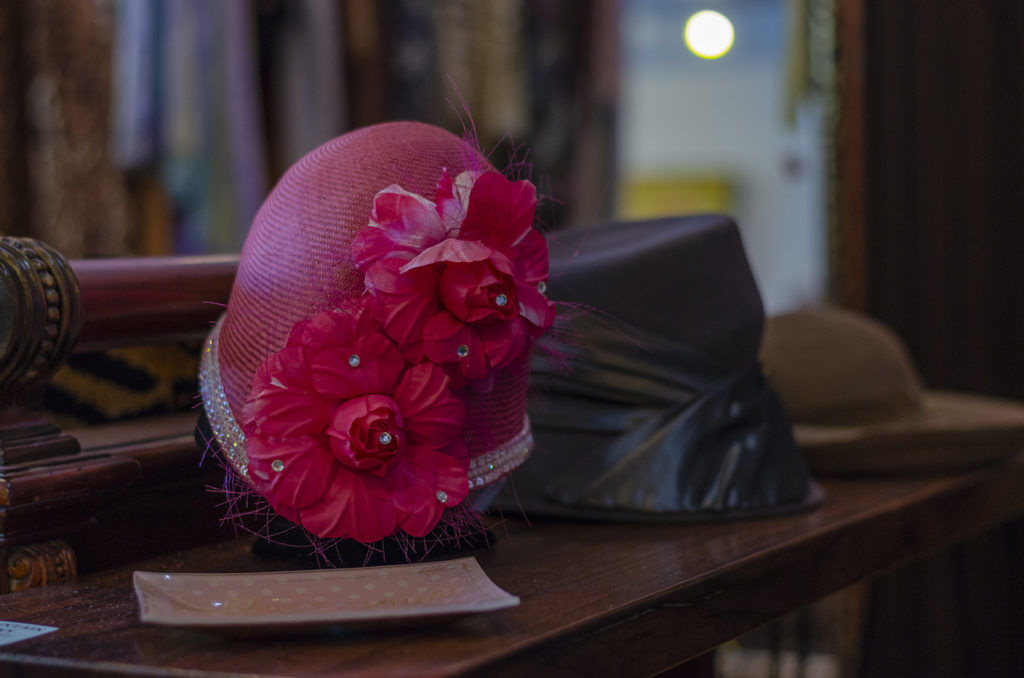 hot pink hat at the cinderella complex boutique in fair oaks village