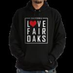 man wearing a hoodie sweatshirt with the love fair oaks logo