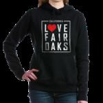 woman wearing a hoodie with love fair oaks on it