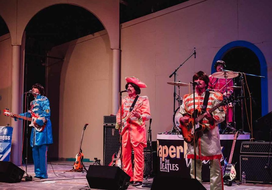 paperback writer beatles cover band performing on stage at fair oaks theatre festival